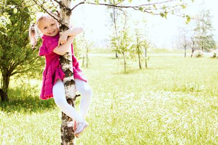 tenacious: Small in dress girl on the tree