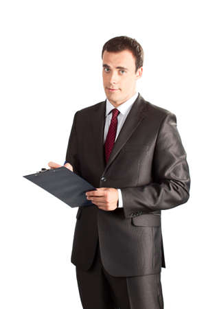 Successful businessman writing in clipboard isolated on white background