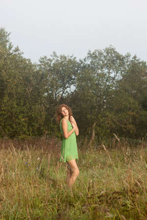 Photo of romantic woman in fairy forest. Beauty summertime photo