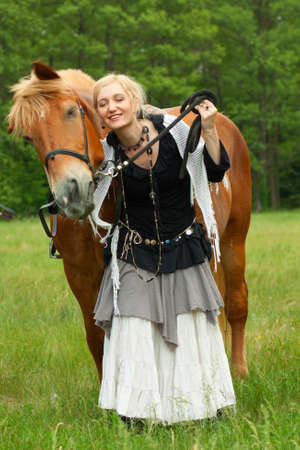 Woman in boho style with horse on meadow Stock Photo - 15683728