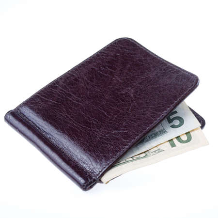 Brown leather wallet with bank notes isolated on white background photo