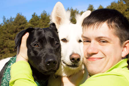 Friends. Man and his dogs together.