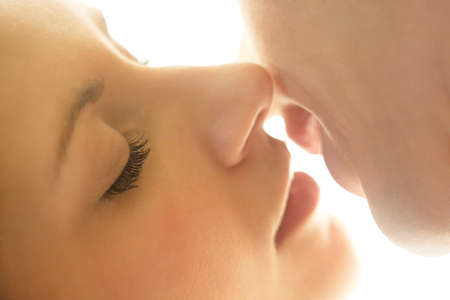 Portrait of young caucasian couple kissing. Close up. photo