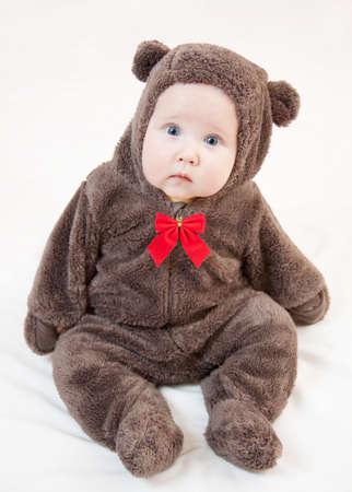 Beautiful baby in christmas costume of bear photo