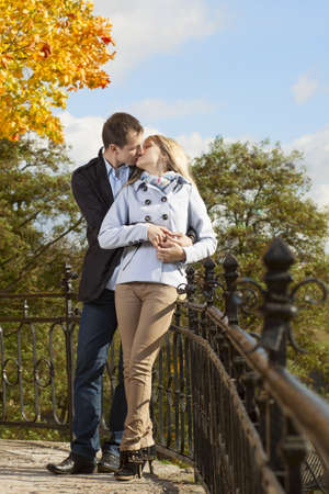 Romantic couple kissing in autumn park near the rails Stock Photo - 17053901