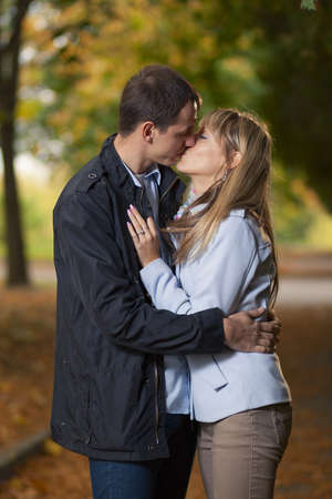 young couple hugging kissing: Romantic couple kissing in autumn park