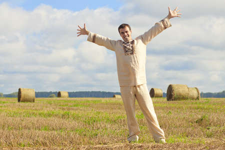 freetime: Carefree man standing in golden wheat field being happy enjoying freetime