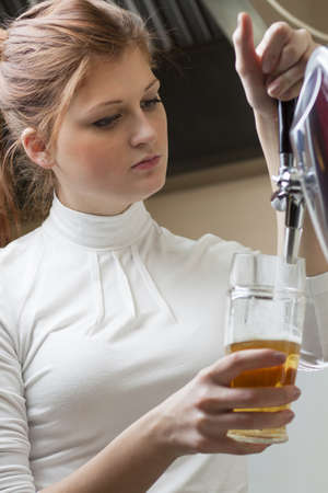 waiting woman pouring beer into the glass Stock Photo - 17547585