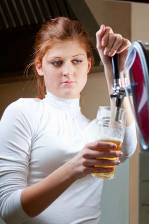 waiting woman pouring beer into the glass Stock Photo - 17620343