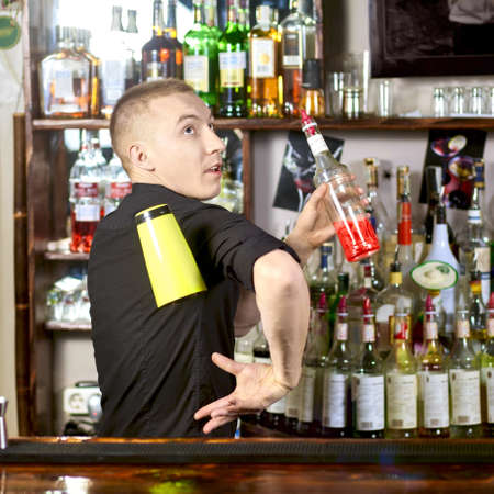 Professional barmen making cocktail in night club