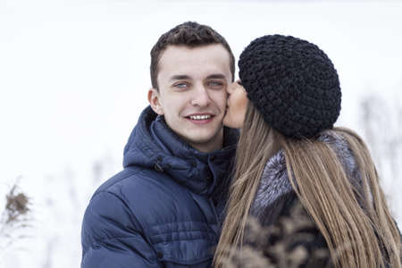 Happy Young Couple in Winter field having fun. photo