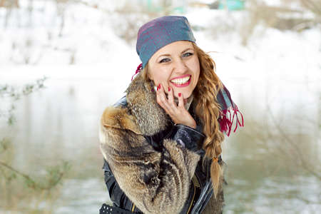 Portrait of young laughing woman in winter forest. photo