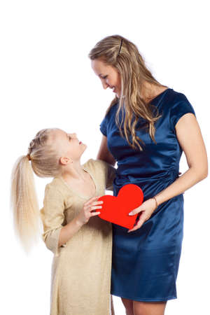 Mother and her daughter keeps heart and looks to each other photo