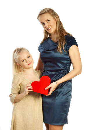 Mother and her daughter keeps heart and looks photo