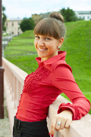 Beautiful young caucasian woman in red blouse. Stock Photo - 18333736