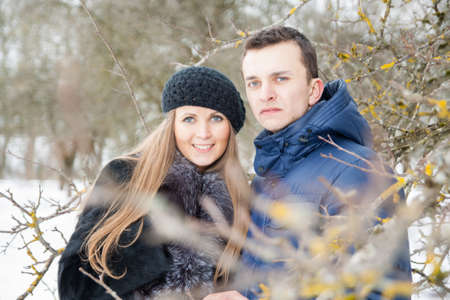 winter garden: Happy Young Couple in Winter garden embracing Stock Photo