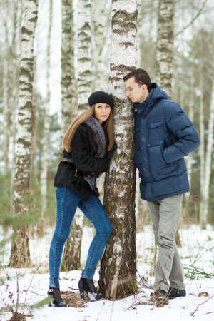 birchwood: Happy Young Couple in Winter birchwood walking