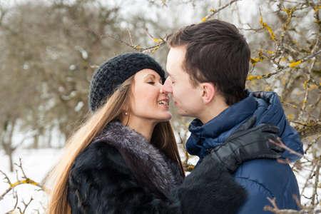 winter garden: Happy Young Couple in Winter garden kissing.