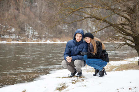 Couple playing on the coast of winter river Stock Photo - 18485541