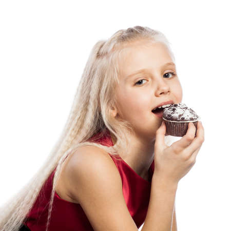 Girl biting a chocolate cake. Isolated on white background. photo
