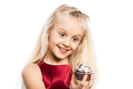 Surprised girl looking at cake. Isolated on white background. photo
