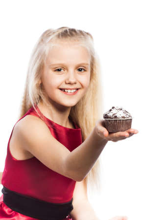Girl giving at cake. Isolated on white background. photo