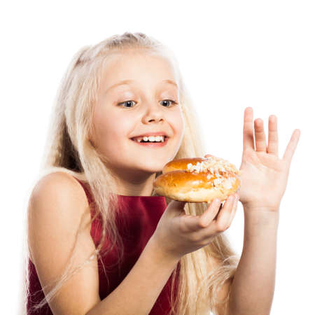 Girl looking at croissant. Isolated on white background. photo
