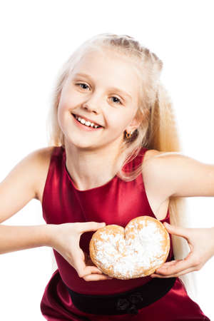 Girl holding a heart-shaped biscuit. Isolated on white background. Stock Photo - 18995330