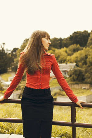 Beautiful young caucasian woman in red blouse. photo