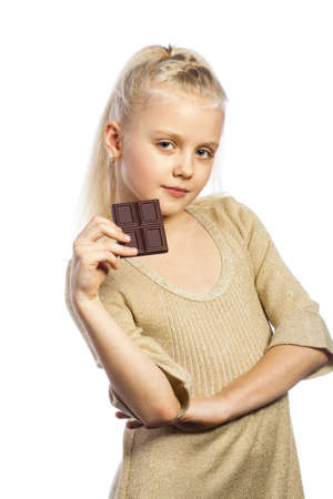 Beautiful girl with plate of chocolate. Isolated on white background. photo