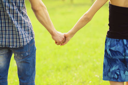 Couple hands closed together in summer Stock Photo