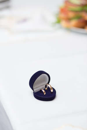 Wedding rings in blue box on a tabl photo