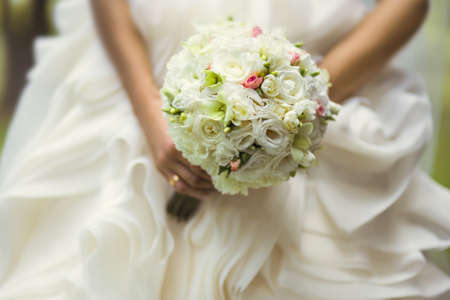 wedding accessories: Beautiful wedding bouquet in hands of the bride