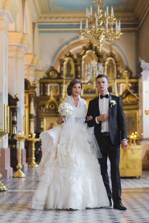 Wedding - young couple just married inside of church Stock Photo - 22338976