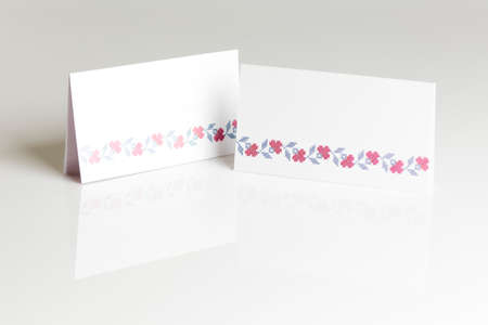 Blank place card for wedding table placing on gray background photo
