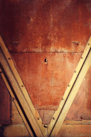 sheathing: grunge rusty wet metal sheathing with rivets Stock Photo