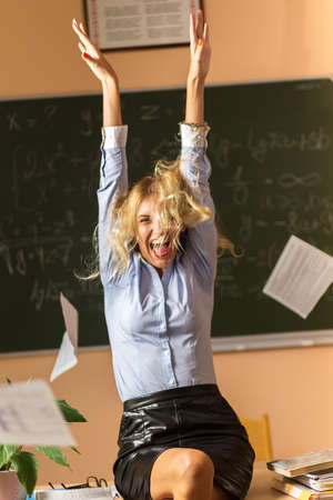 school girl sexy: Young pretty teacher screaming in the class room Stock Photo