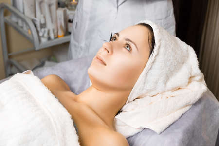 skin care, female relaxing after applying face mask cream photo