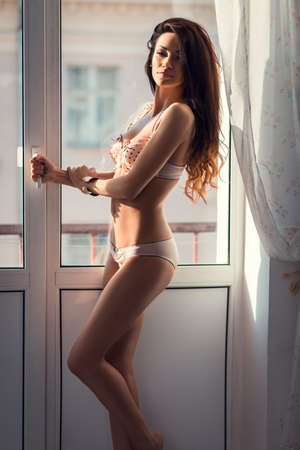 naked sexy girl: Sexy girl posing in underwear near the window