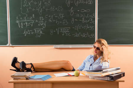 Beautiful young sexy teacher resting between the classes photo