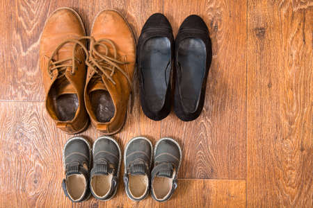 Shoes for the entire family on the floor photo