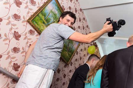 filmmaker: Amateur videographer to shoot the wedding indoors.