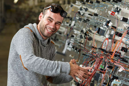 happy worker: Happy worker that manufacture the wiring for the car