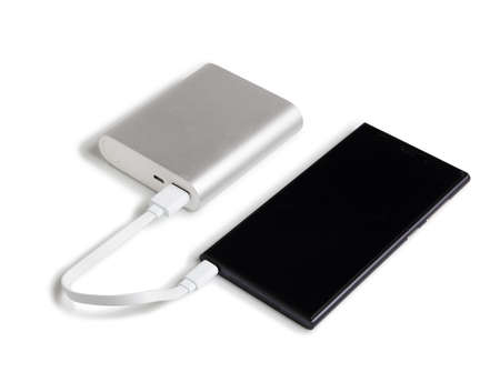 power cable: smartphone is charging from the power bank Stock Photo