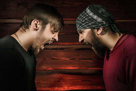 two brutal man looking into each other's eyes