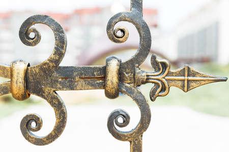 hinge: Decorative metal hinge. Element large wrought-iron gates Stock Photo