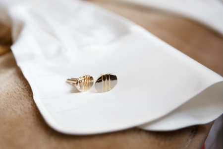 sleeve white mans shirt and gold cufflinks photo