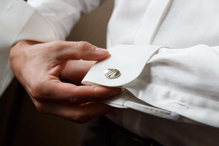 men wear cufflinks on a shirt sleeve photo