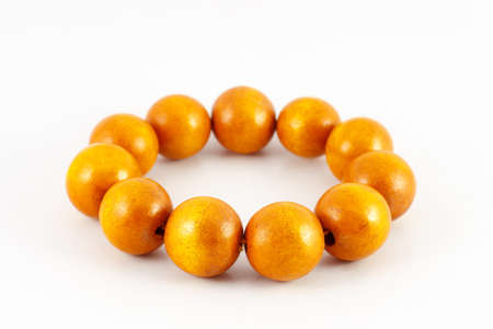 Yellow wooden beads bracelet isolated on white photo