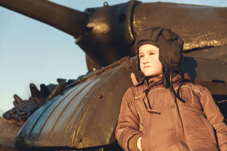 Portrait of young boy standing near by panzer photo